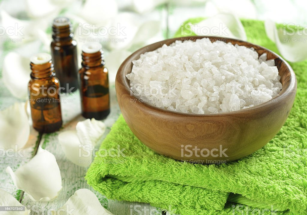 Salt in a wooden bowl and essential oil royalty-free stock photo