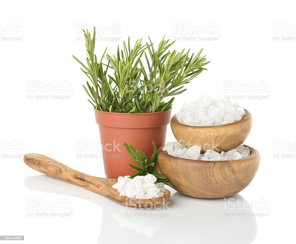 Salt in a wooden bowl and rosemary royalty-free stock photo