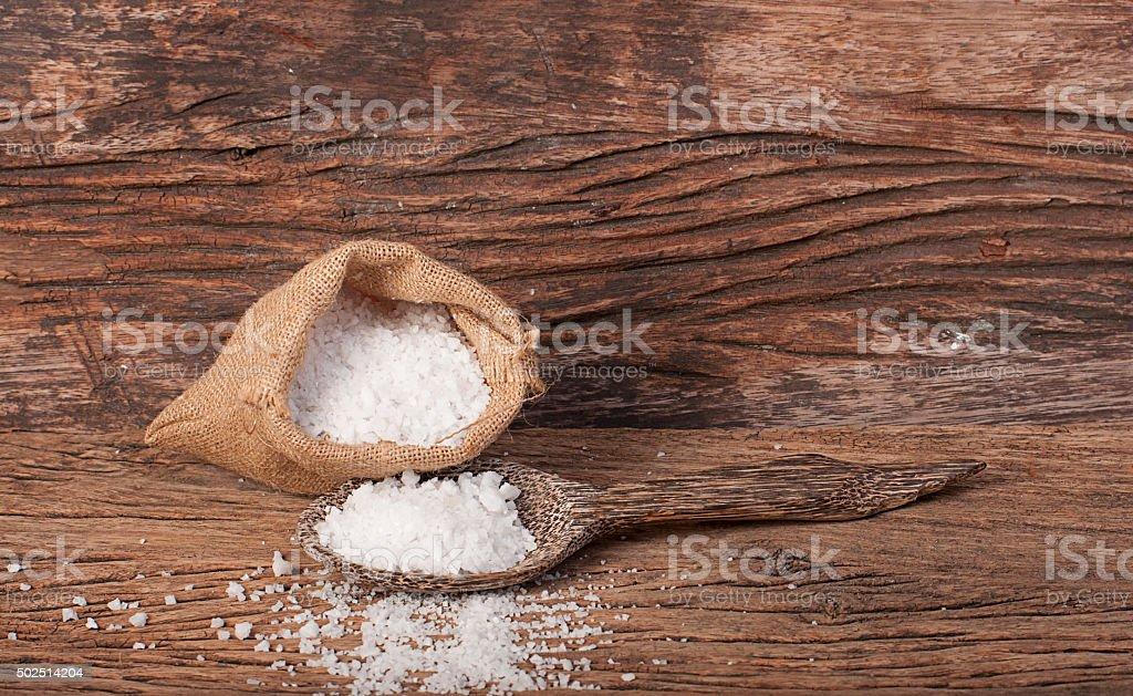 Salt in wooden spoon stock photo