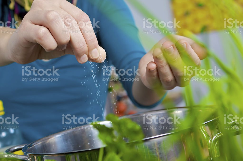 Salt into water royalty-free stock photo