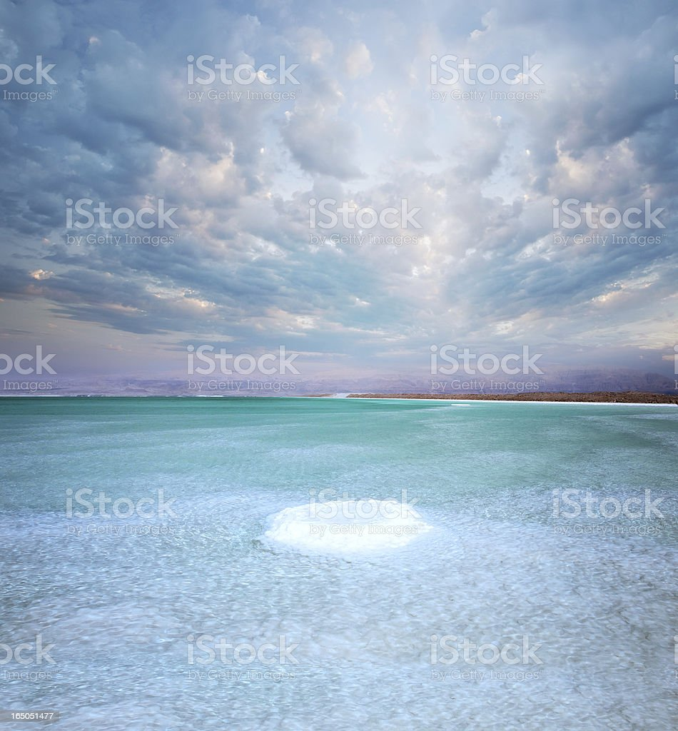 Salt island in Dead sea during sunset and clouds. Israel stock photo