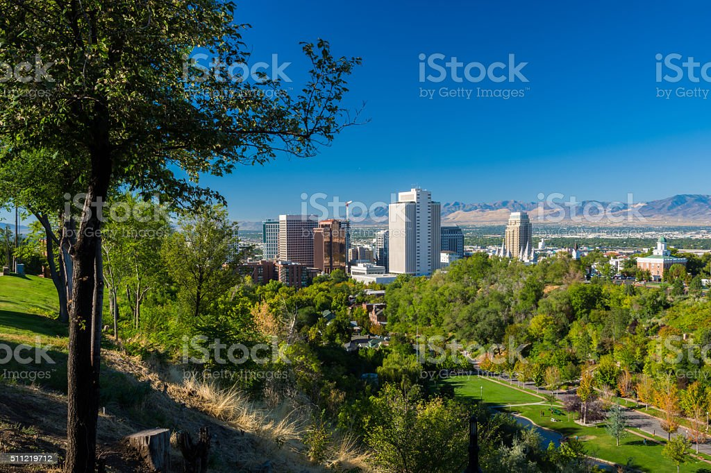 Salt Lake City skyline and lush trees stock photo