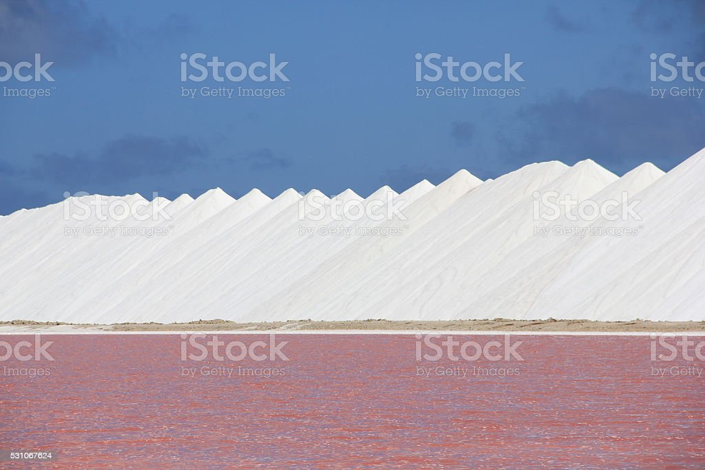 Salt mountains and Pink Water stock photo