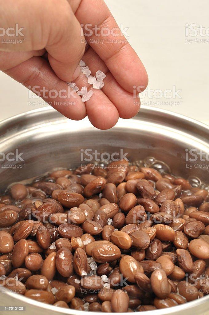 Salt on beans stock photo