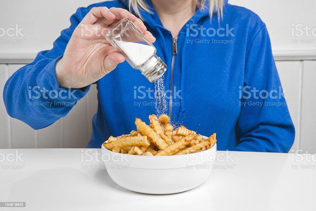 Salt on french fries stock photo