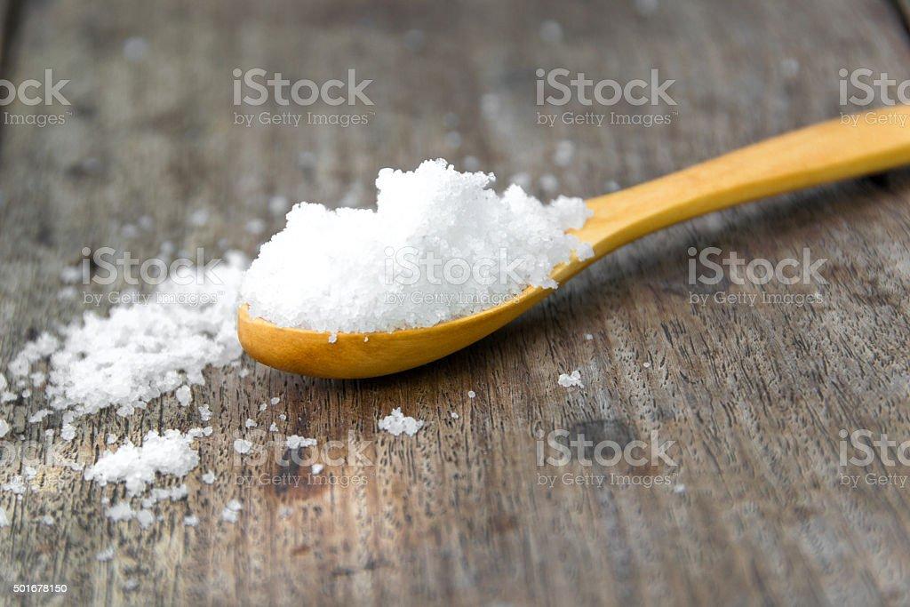 salt on wood background stock photo