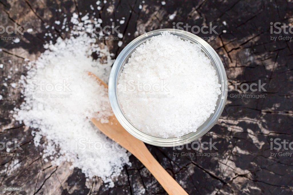 Salt on wooden block stock photo
