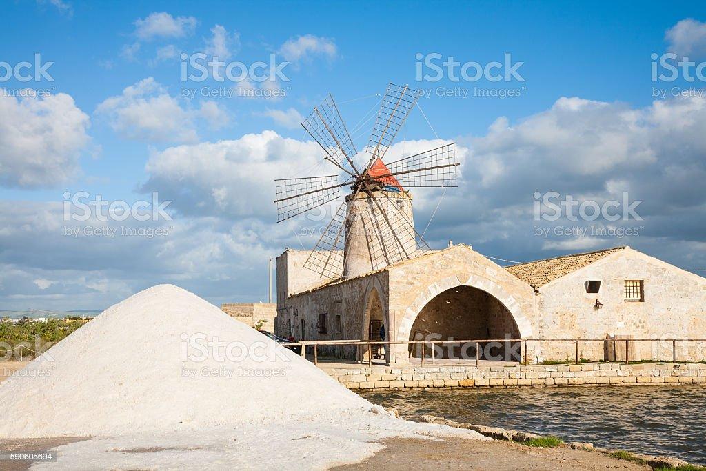 Salt pan windmill stock photo