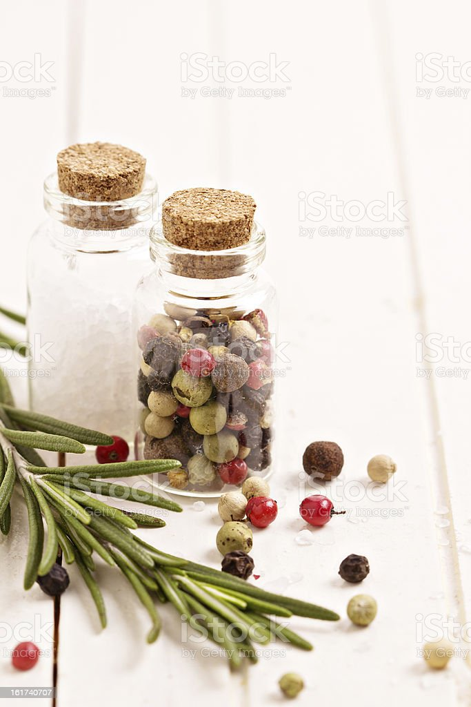 Salt, pepper and rosemary on white table royalty-free stock photo
