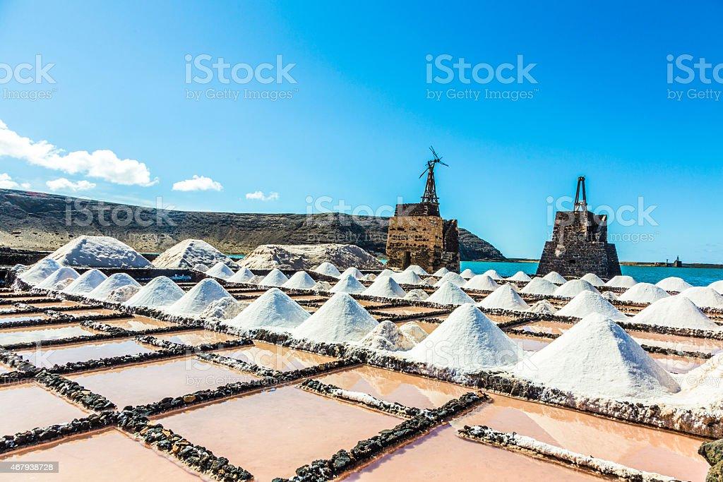salt piles in the saline of Janubio in Lanzarote stock photo