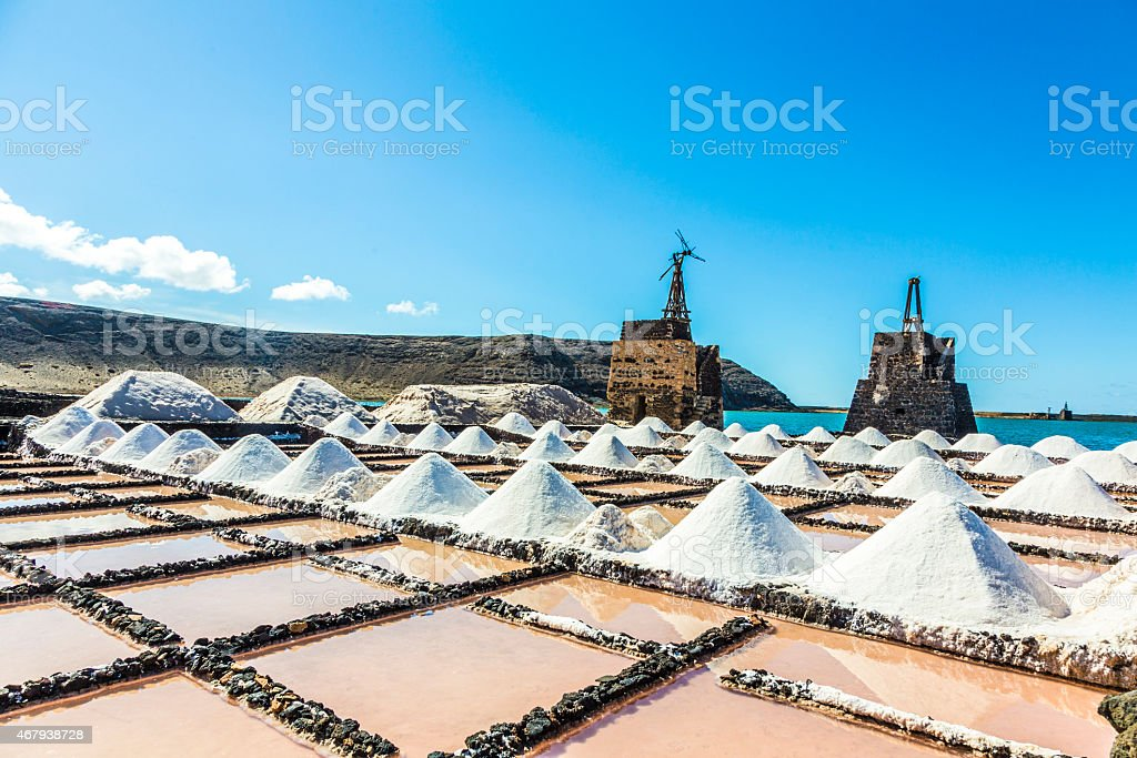 salt piles in the saline of Janubio in Lanzarote stock photo
