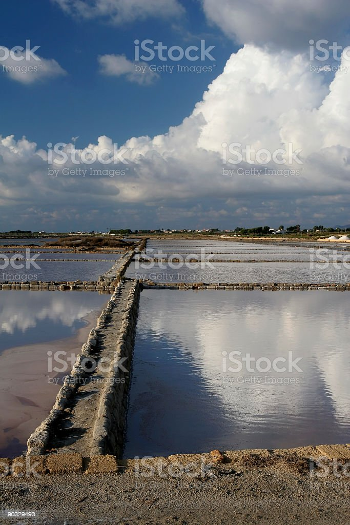Salt Ponds and Clouds in Sicily royalty-free stock photo
