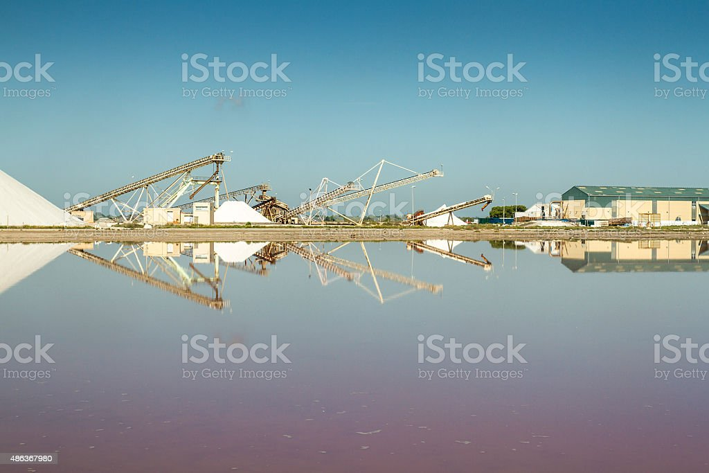 Salt production in a salt flats - Aigues-Mortes stock photo