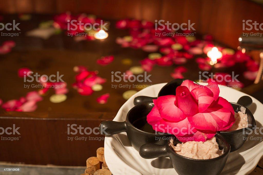 salt scrub and bath tub in spa stock photo
