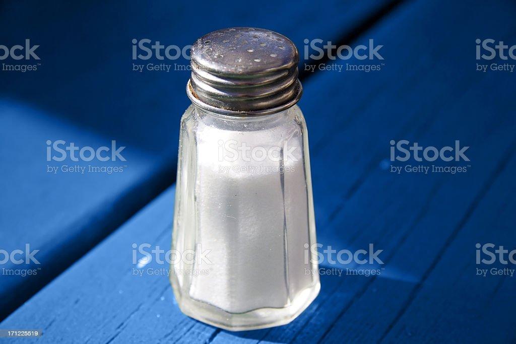 Salt shaker on blue stock photo