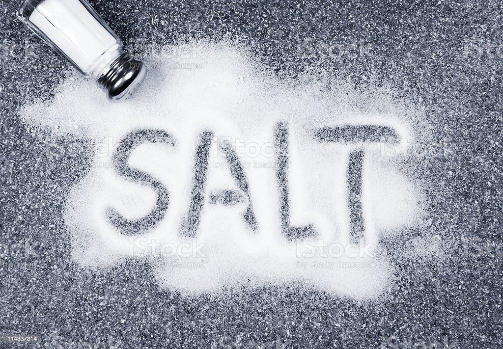 Salt spilled from shaker stock photo