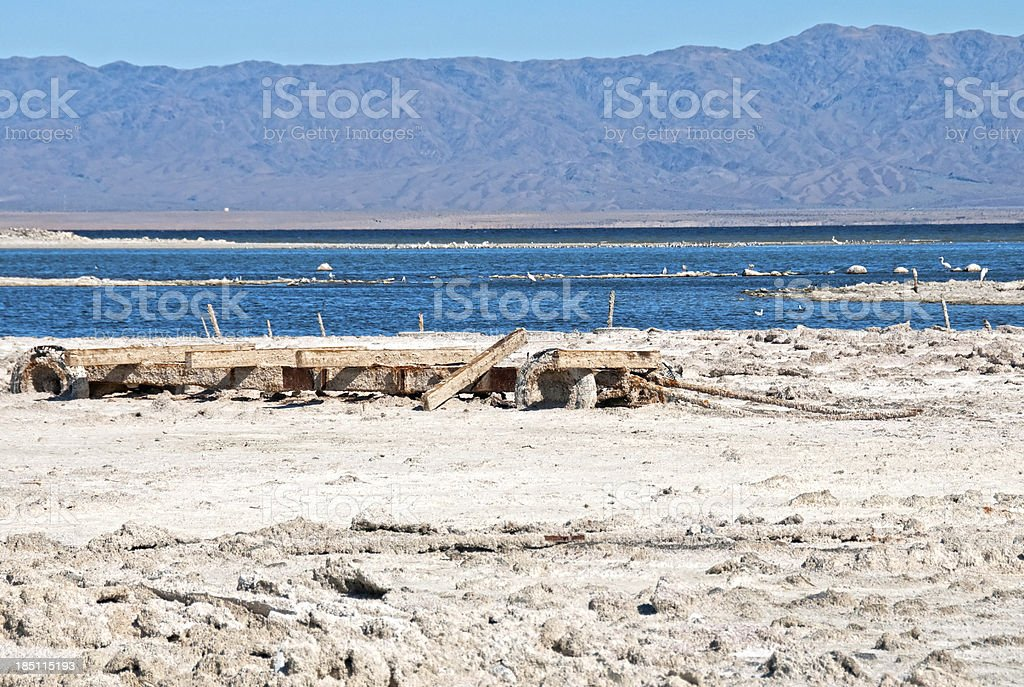 Salt-crusted boat trailer sunk in beach of Salton Sea royalty-free stock photo