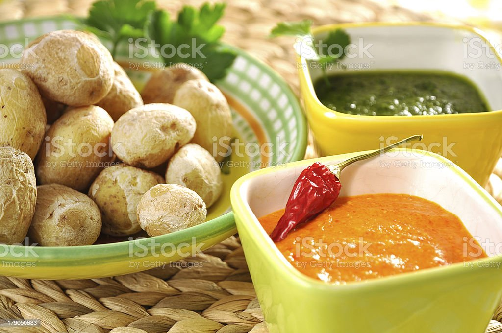 Salt-crusted potatoes with salsa royalty-free stock photo
