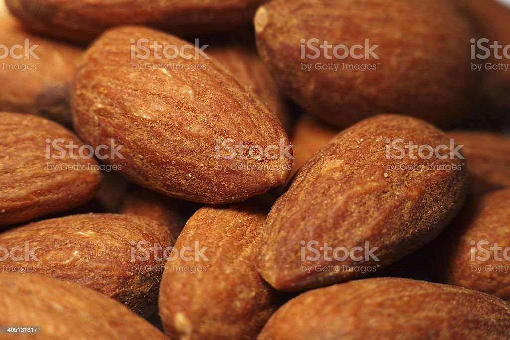 Salted Almonds closeup background stock photo