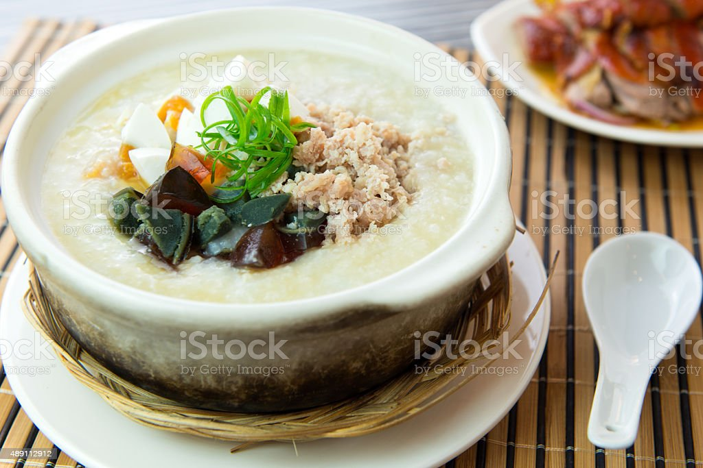 Salted and preserved egg chicken floss congee stock photo