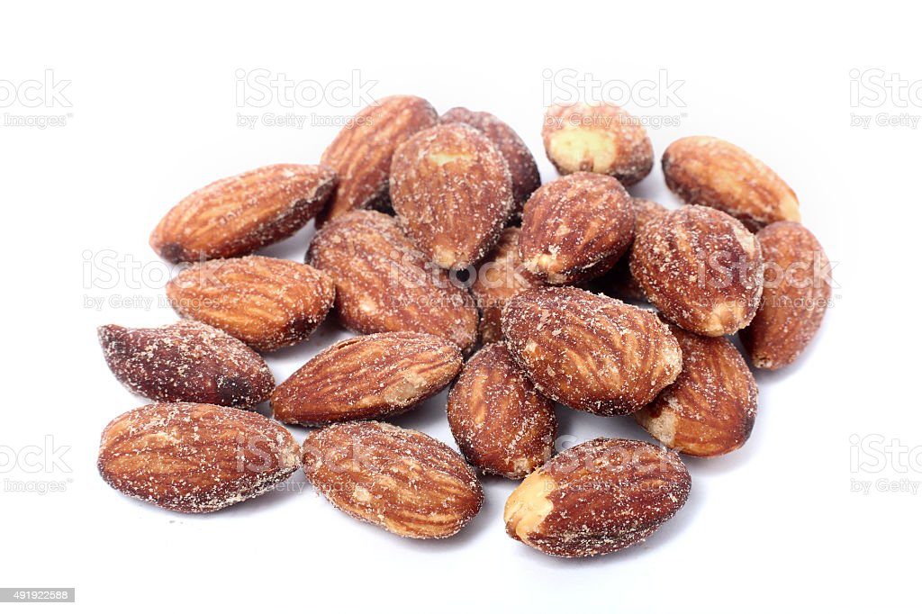 salted and roasted almonds stock photo