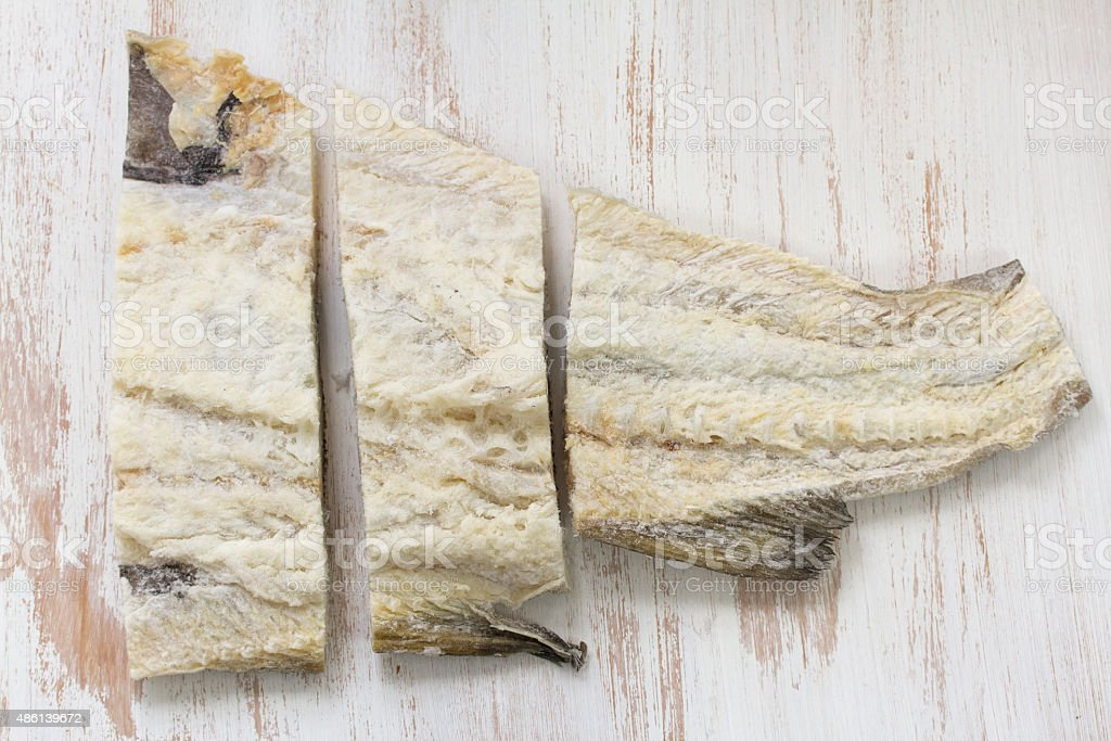salted cod fish on white background stock photo