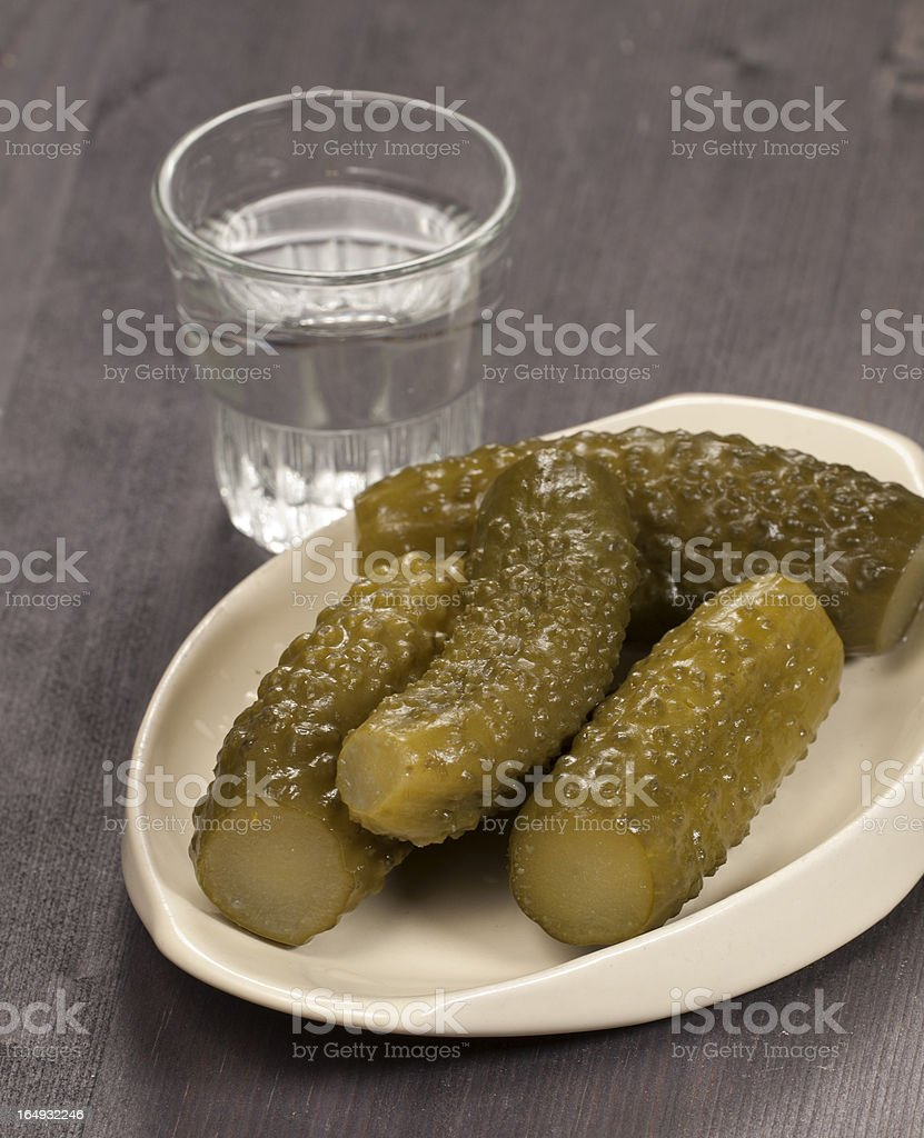 Salted cucumbers and vodka stock photo