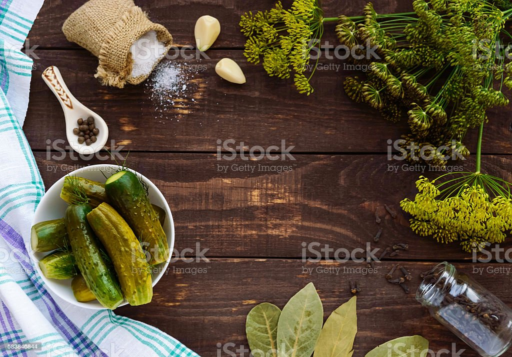 Salted cucumbers. Spices and herbs for making pickles. stock photo
