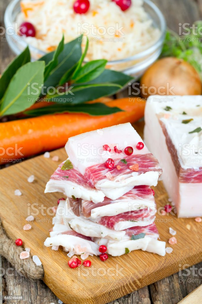 salted lard and spices on wooden surface stock photo