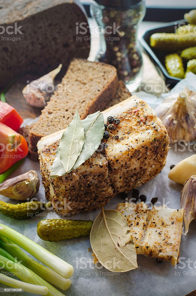 Salted lard with spices and vegetables. stock photo
