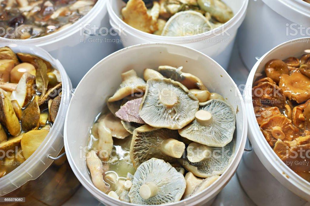 Salted mushrooms on market stock photo