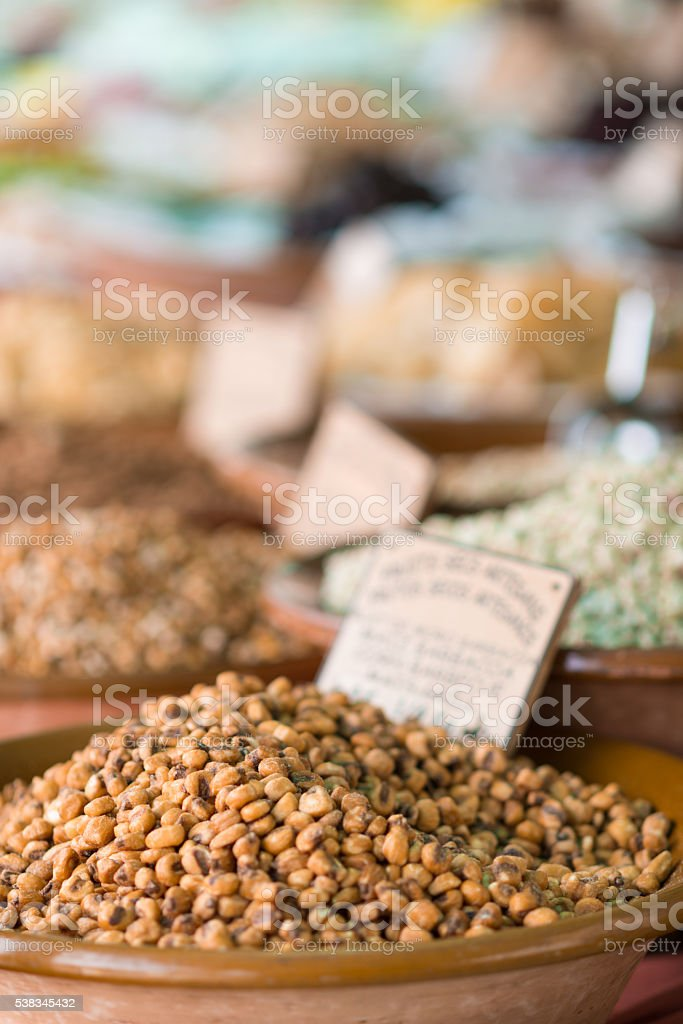 salted nuts on a market stall stock photo