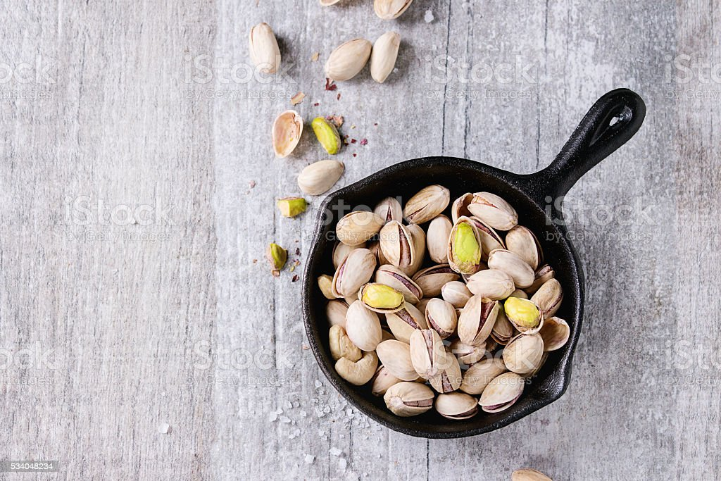 Salted roasted pistachios stock photo