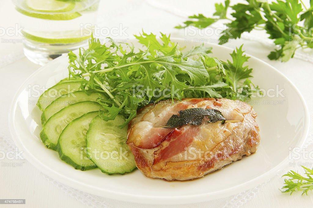 Saltimbocca with cucumber salad. stock photo