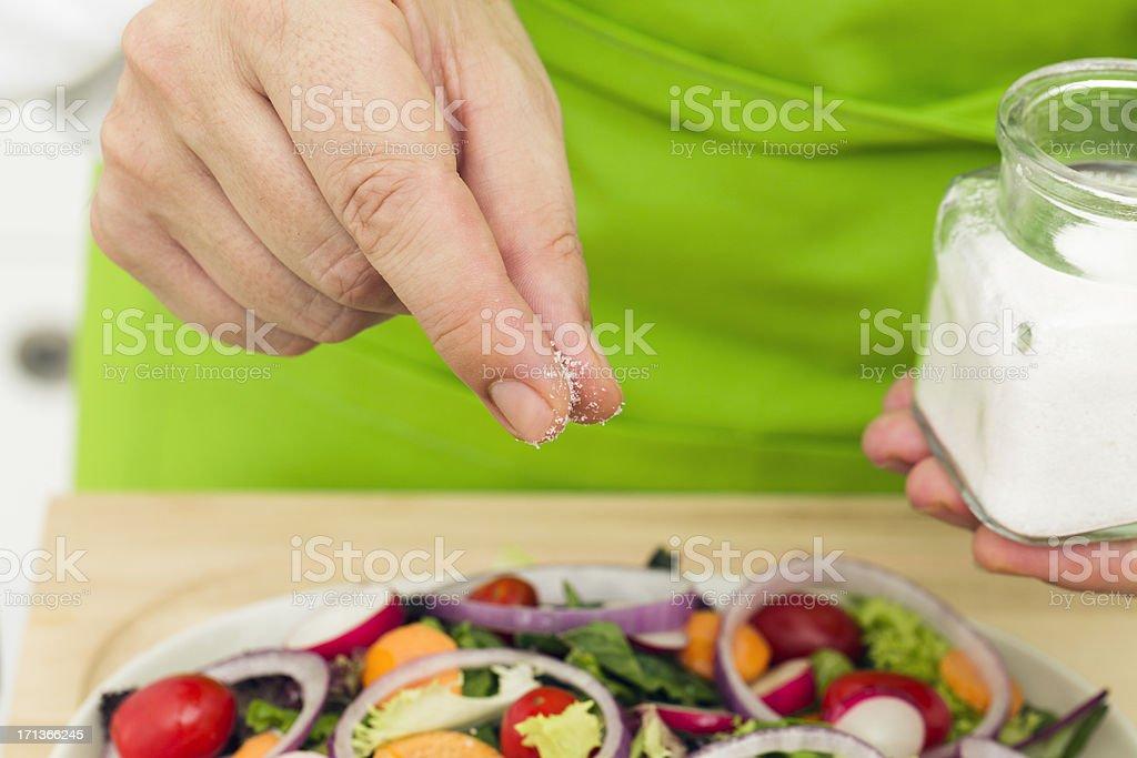 Salting salad stock photo