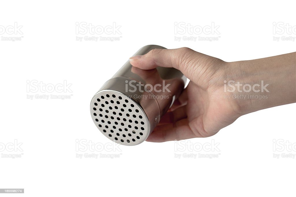 Saltshaker in Woman's Hand(With Clipping Path) royalty-free stock photo