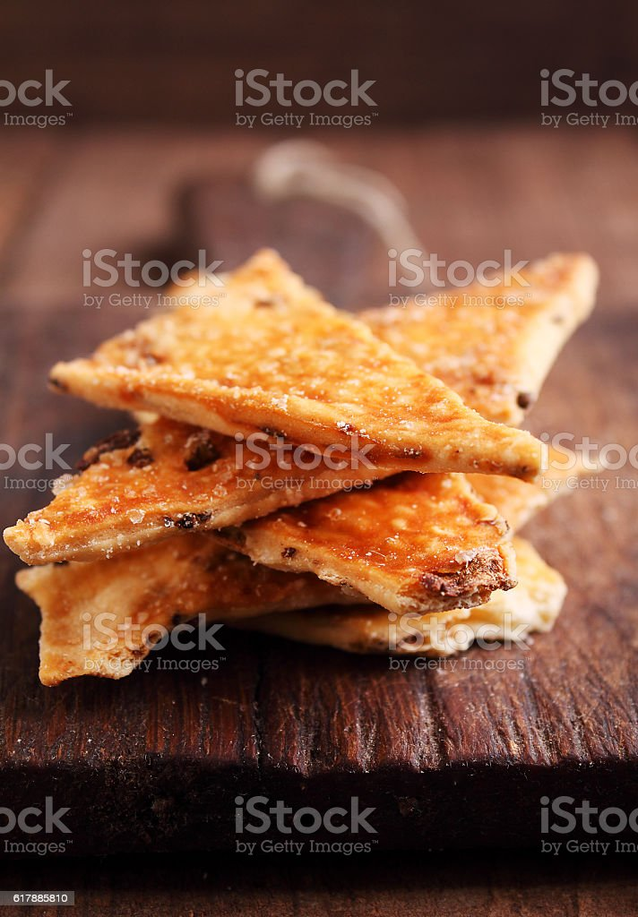salty cookies (crackers) on a dark background. selective focus. stock photo