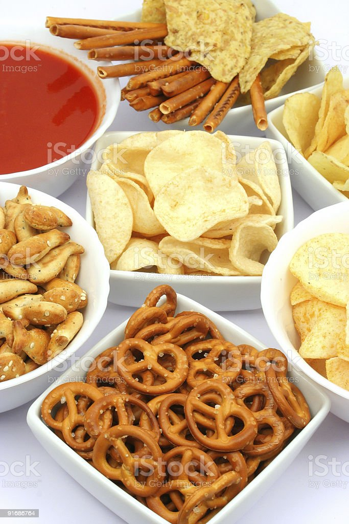 Salty snacks and salsa dip stock photo