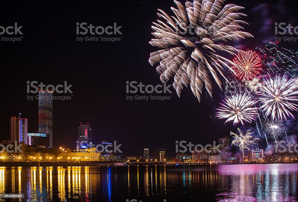 salute in Yekaterinburg city pond and downtown night stock photo