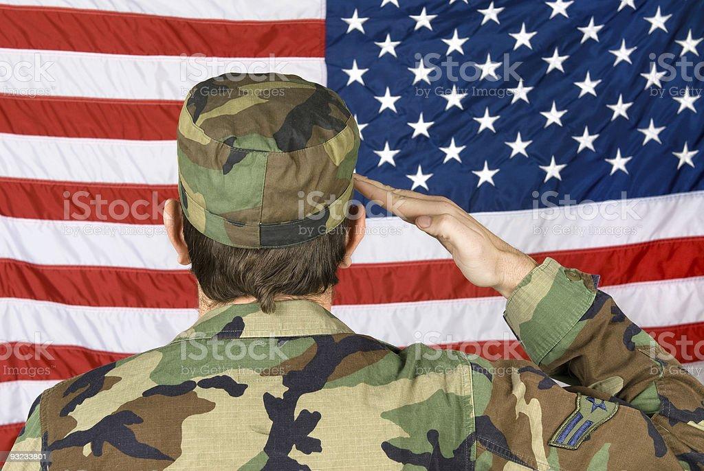 Saluting the American Flag stock photo