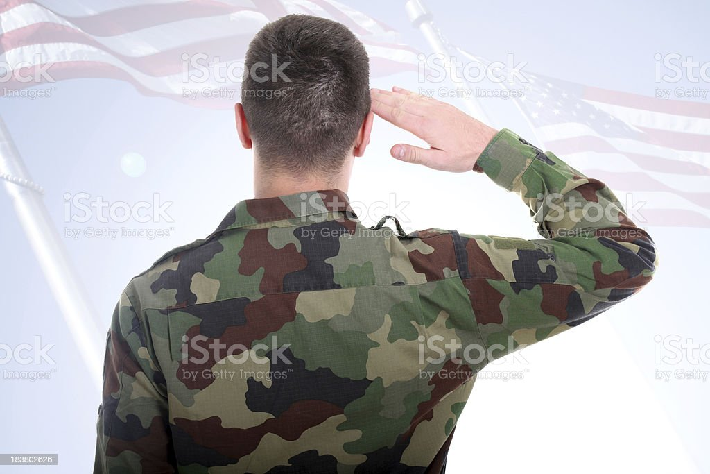 Saluting to American flag royalty-free stock photo