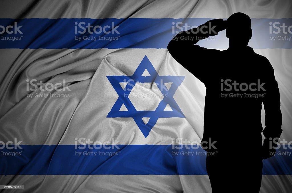 Saluting to Israel flag stock photo