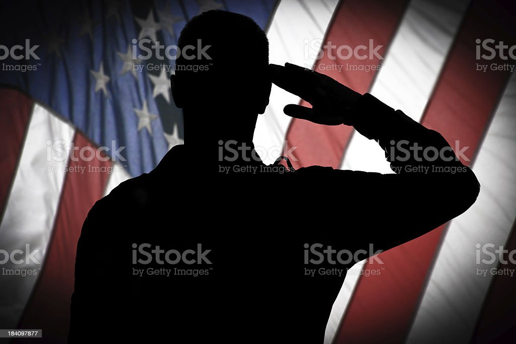 Saluting to USA flag stock photo