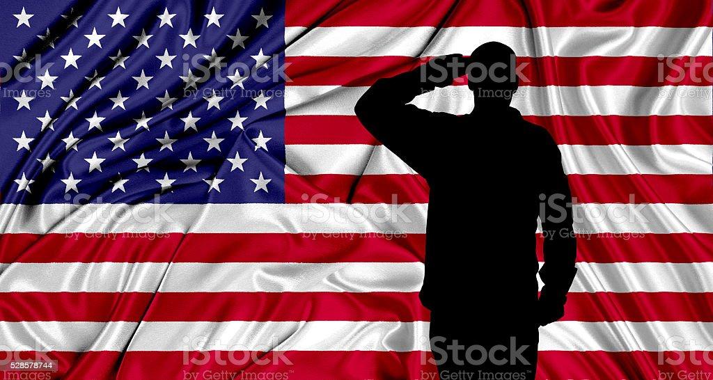 Saluting to USA flag stock photo