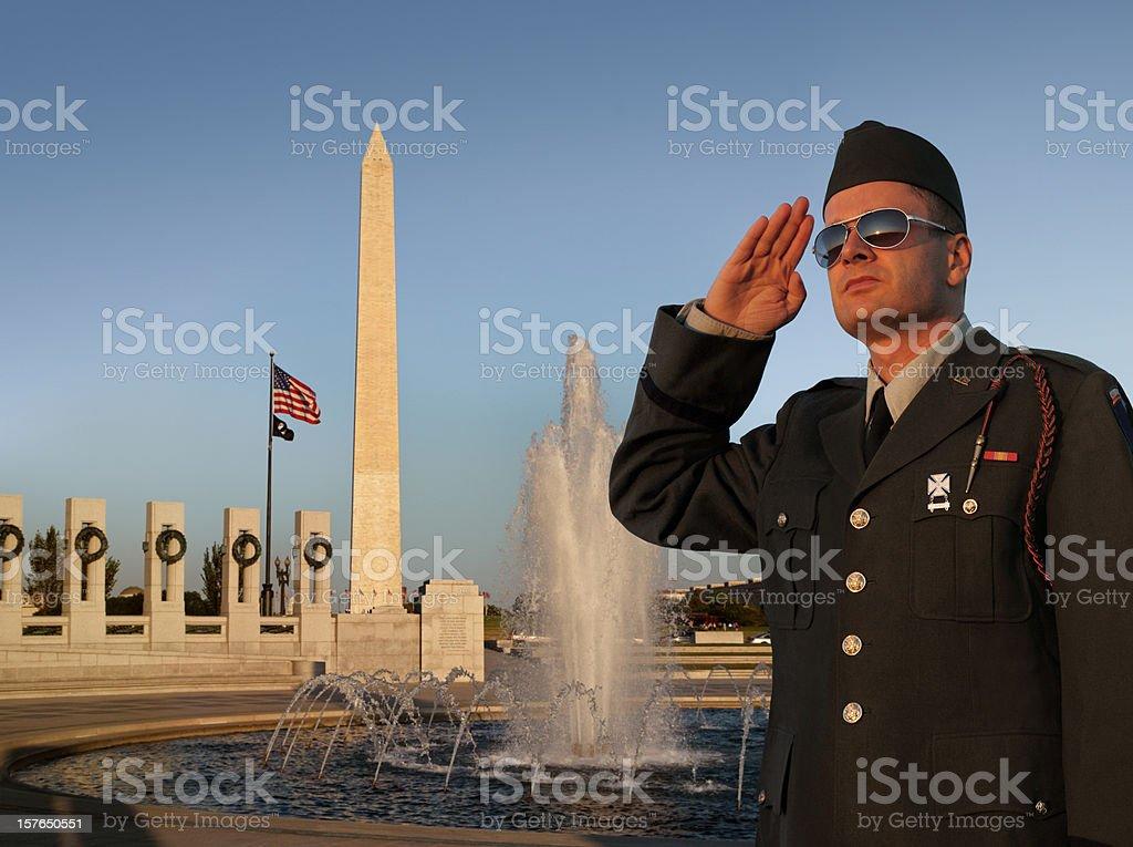 Saluting US Soldier at Washington DC World War II Memorial royalty-free stock photo