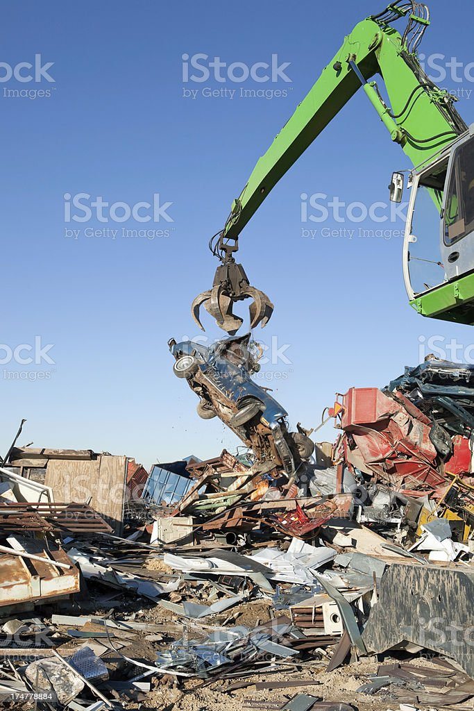 Salvage Yard Grappling Claw Releasing Scrap Car royalty-free stock photo