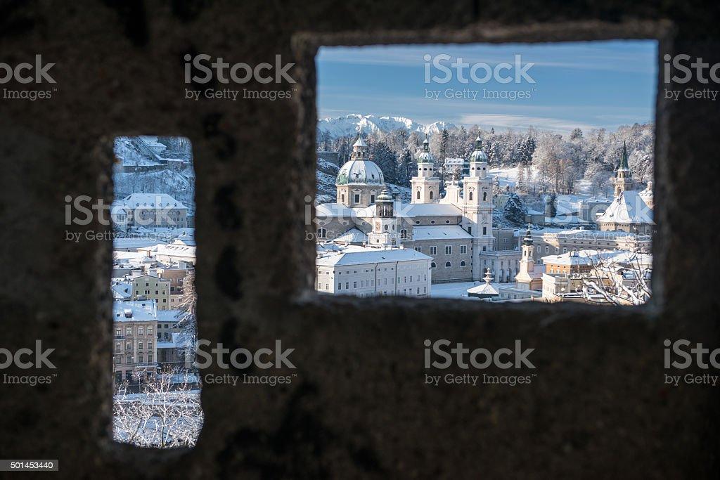Salzburg covered in Snow, Seen through a Watchtower Window stock photo