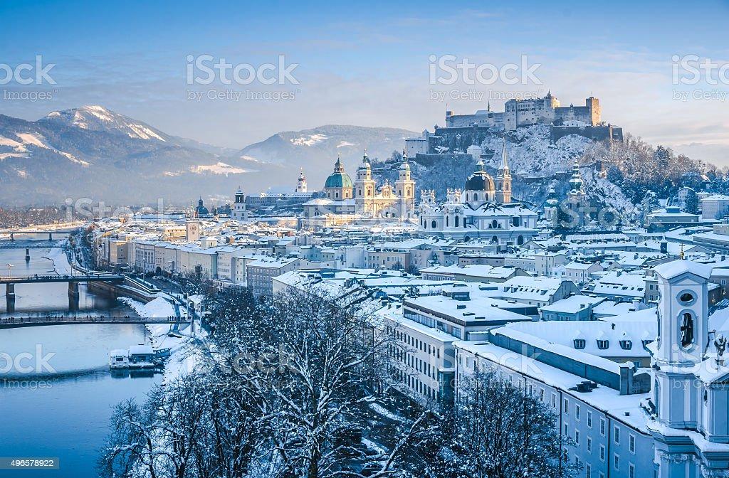 Salzburg skyline with Festung Hohensalzburg and river Salzach in winter stock photo