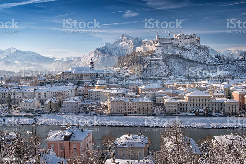 Salzburg with Hohensalzburg covered in Snow, Austrian Alps stock photo