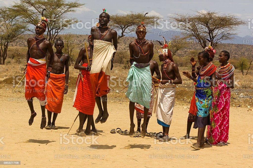 Samburu dancing with tourists in manyatta near Archers Post, Kenya stock photo